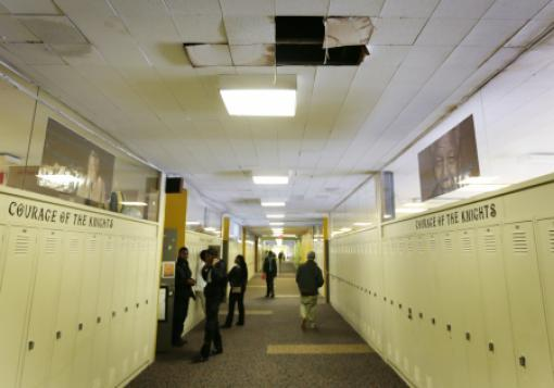 Missing ceiling tiles in a hallway at Osborn Collegiate Academy of Mathematics Science and Technology in Detroit, one of the schools attended by the plaintiffs.