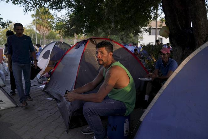 """Nicaraguan asylum-seeker Marlon, sent back to Mexico to await his asylum case under the """"Remain in Mexico"""" policy, poses for a photo in an encampment near in Matamoros, Mexico."""