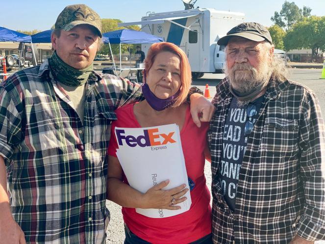 Michael Spradlin, neighbor Kathy Sheldon, and William Spradlin (from left to right)