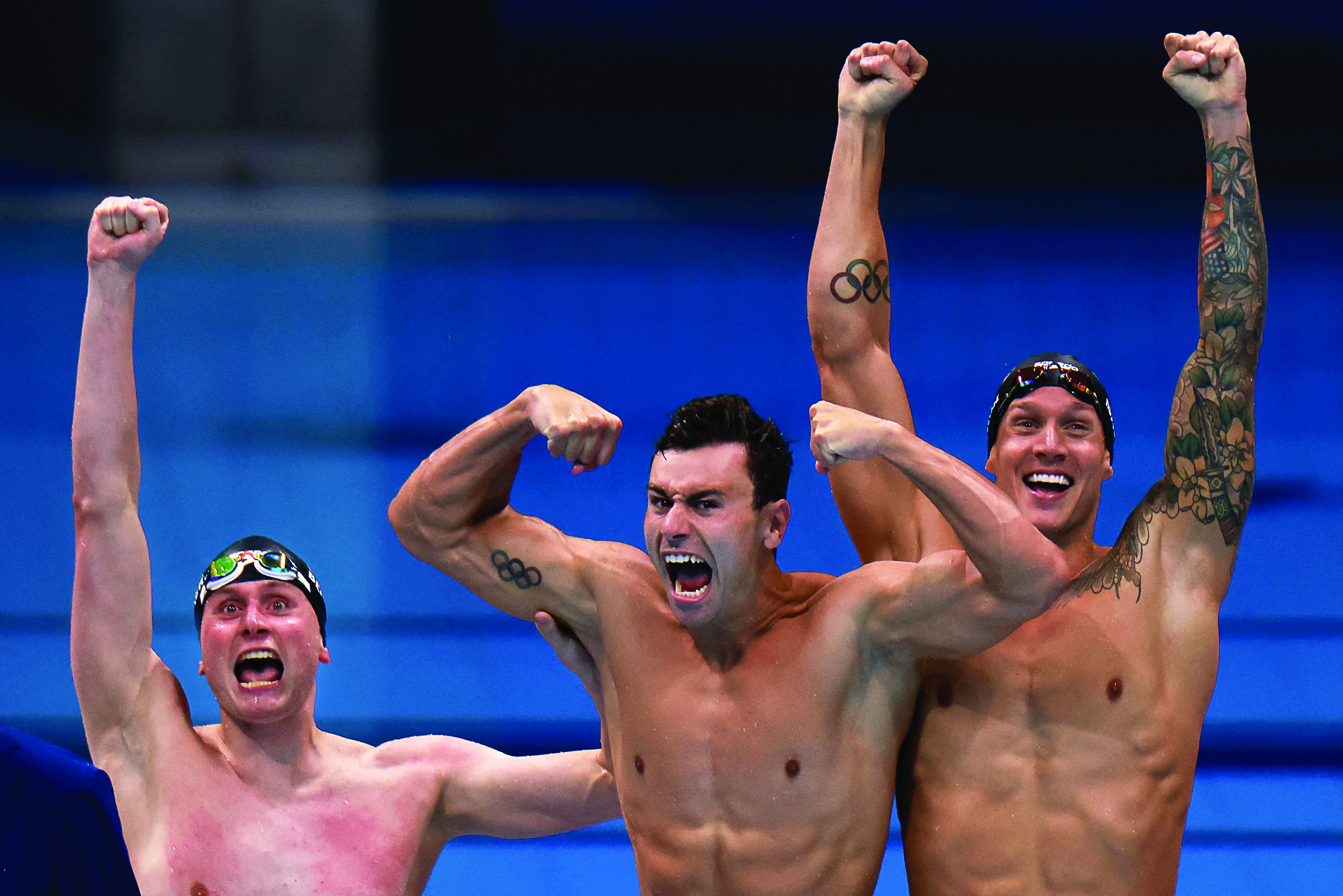 Bowe Becker (left) celebrates with U.S. teammates Blake Pieroni and Caeleb Dressel after winning the gold in the men's 4x100 freestyle relay swimming event at the Tokyo Olympics.