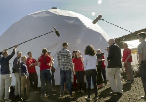 Crew members emerge from an experimental habitat in Hawaii.
