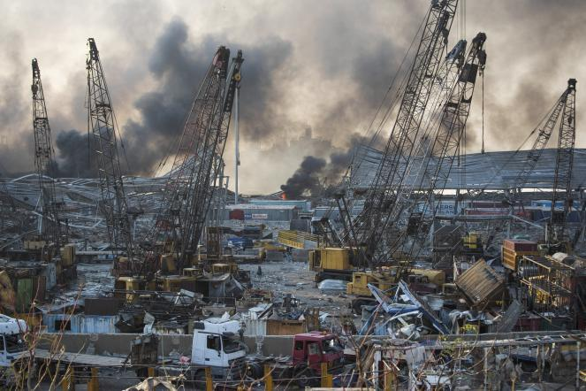 Smoke rises in the aftermath of a massive explosion in Beirut.