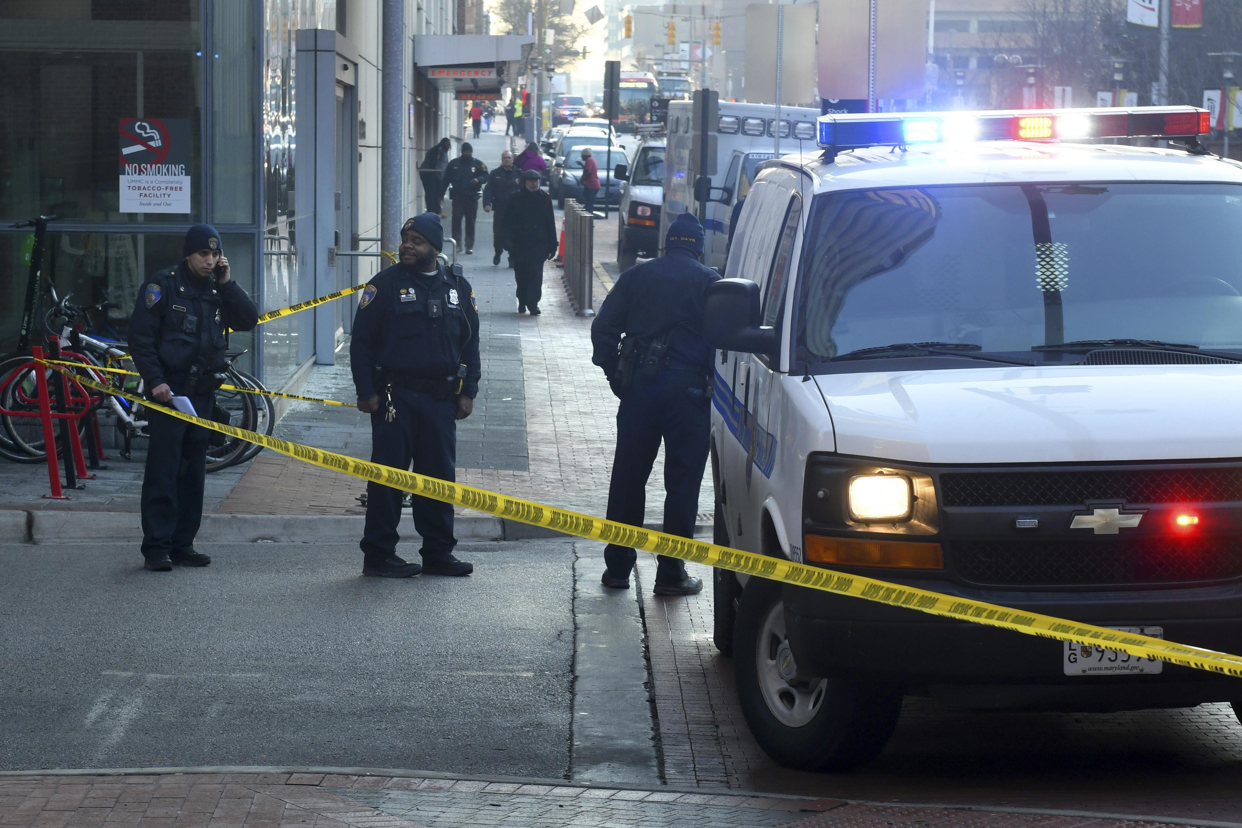 Police block a street in Baltimore after a shooting.