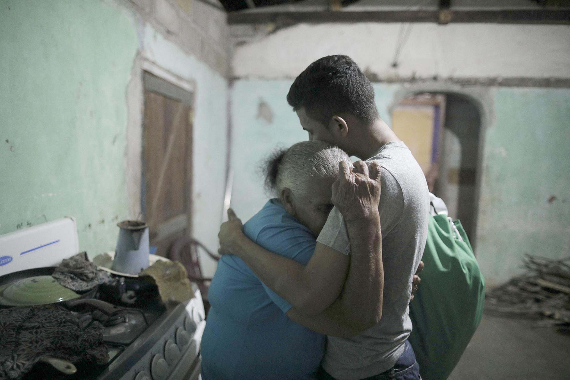 Erwin José Ardón Montoya hugs his grandmother Elda Bardales on Sunday in Colón, Honduras.