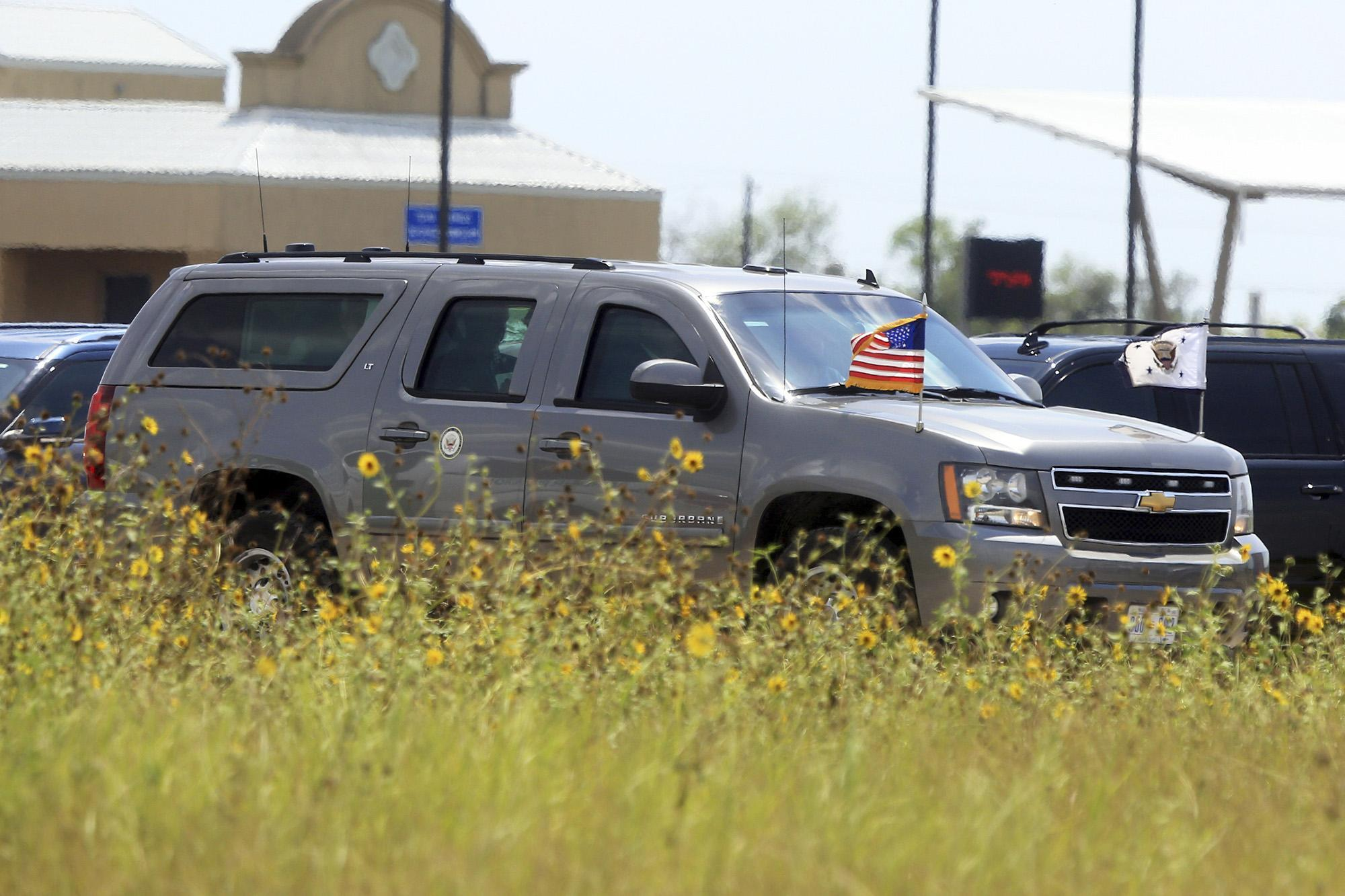 An SUV carrying Vice President Mike Pence leaves a migrant detention facility Friday in Donna, Texas.