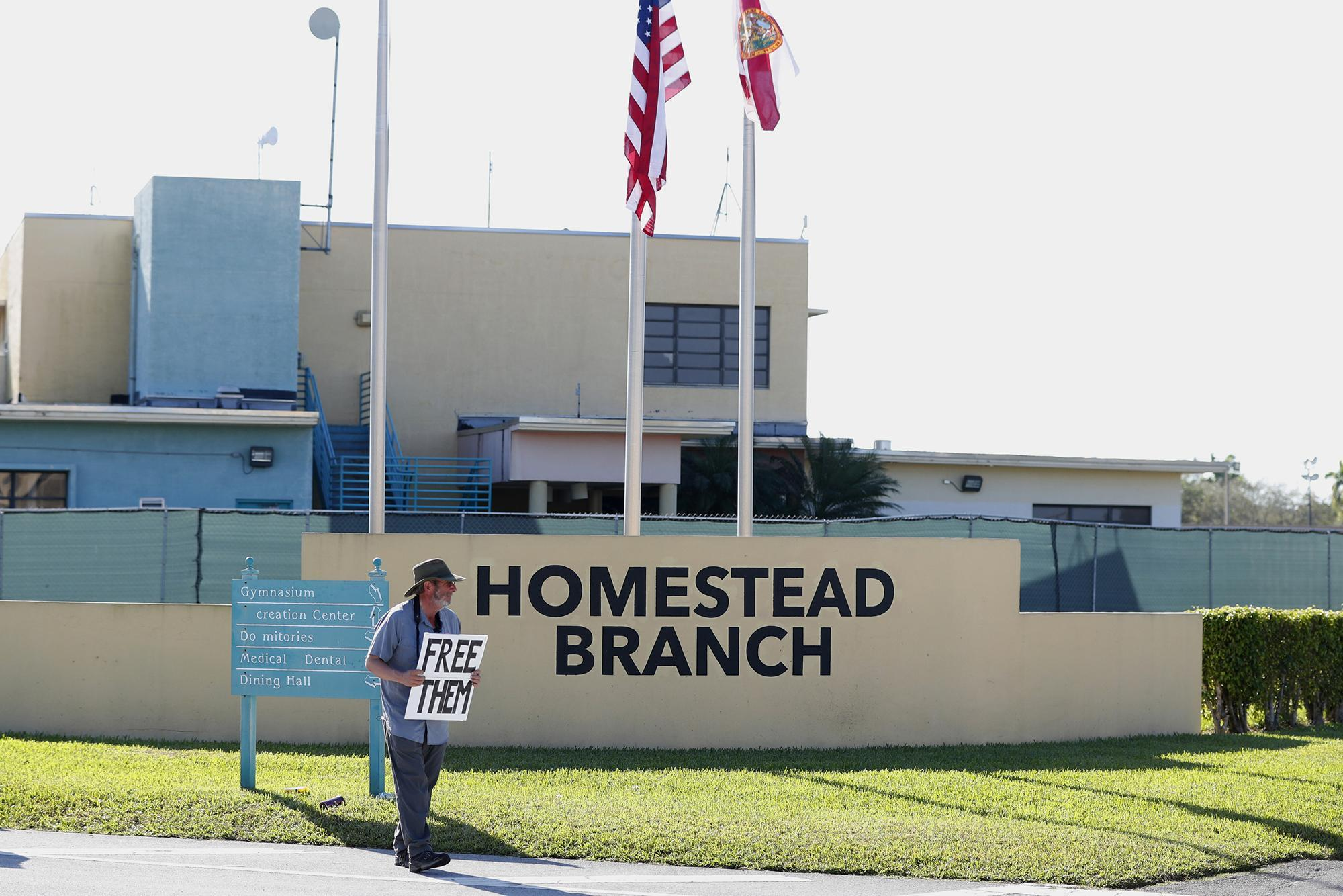 A protester outside the Homestead, Fla., temporary migrant shelter in February