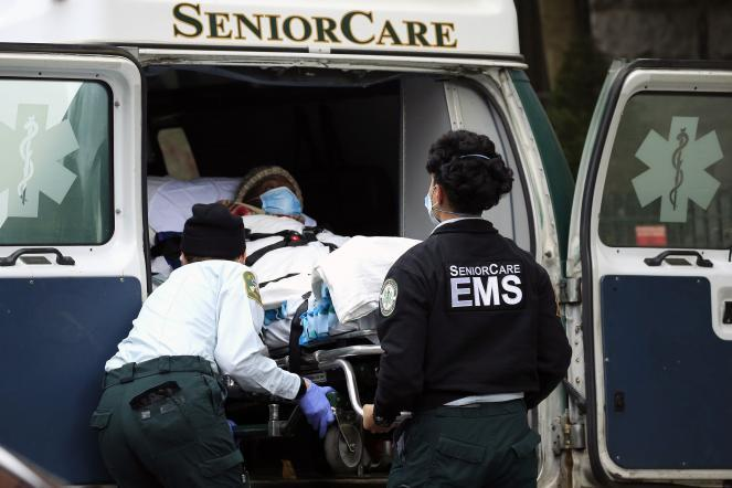 Emergency Medical Service workers unload a patient at Cobble Hill Health Center in Brooklyn, New York.