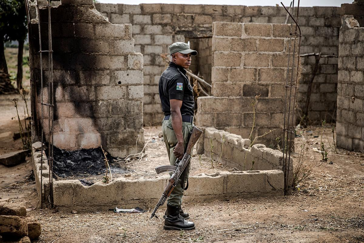A police officer at the site of an attack in the village of Angwan Aku in Kaduna state in Nigeria