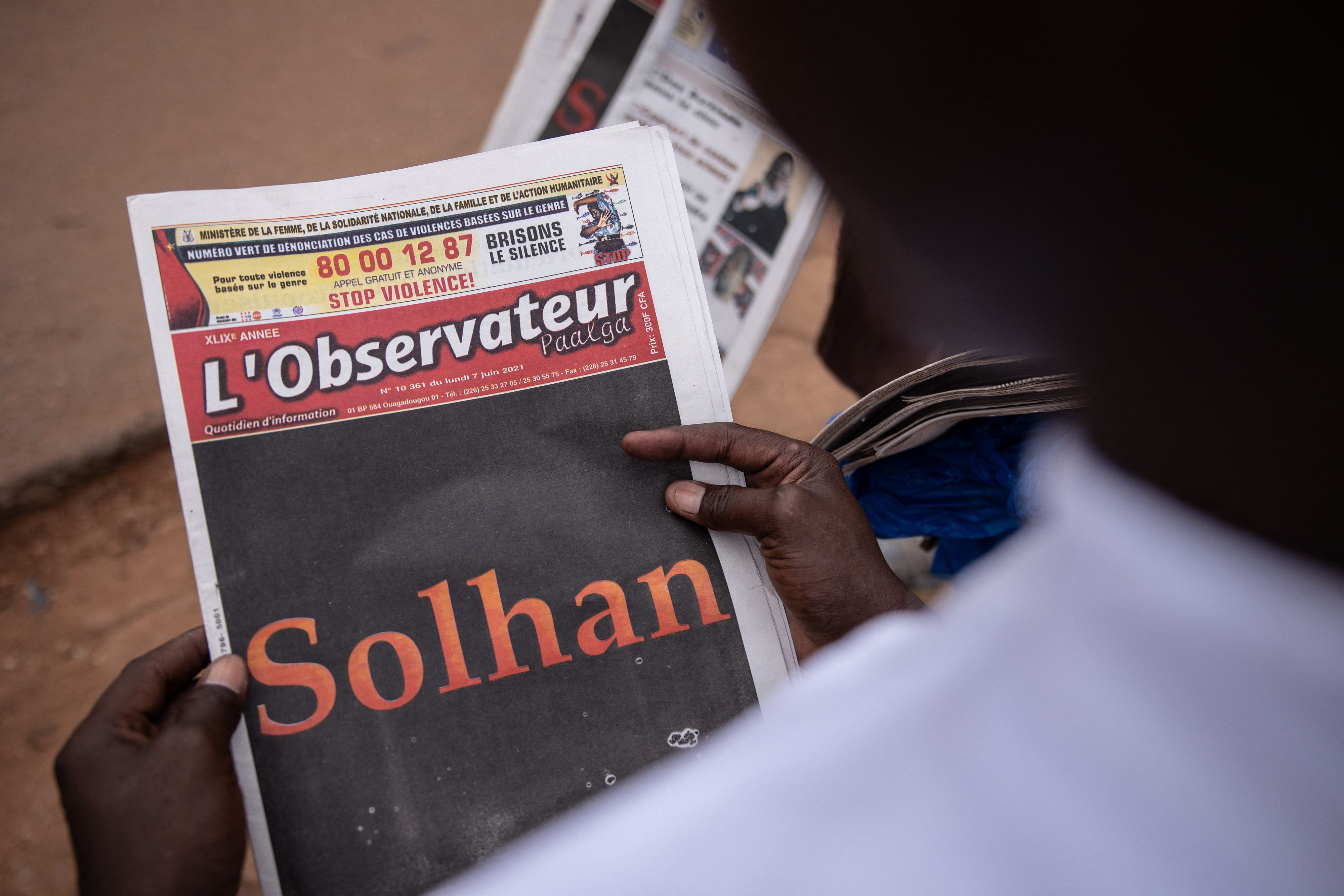 A man reads about the attack in Solhan in the L'Observateur Paalga newspaper in Ouagadougou on Monday.