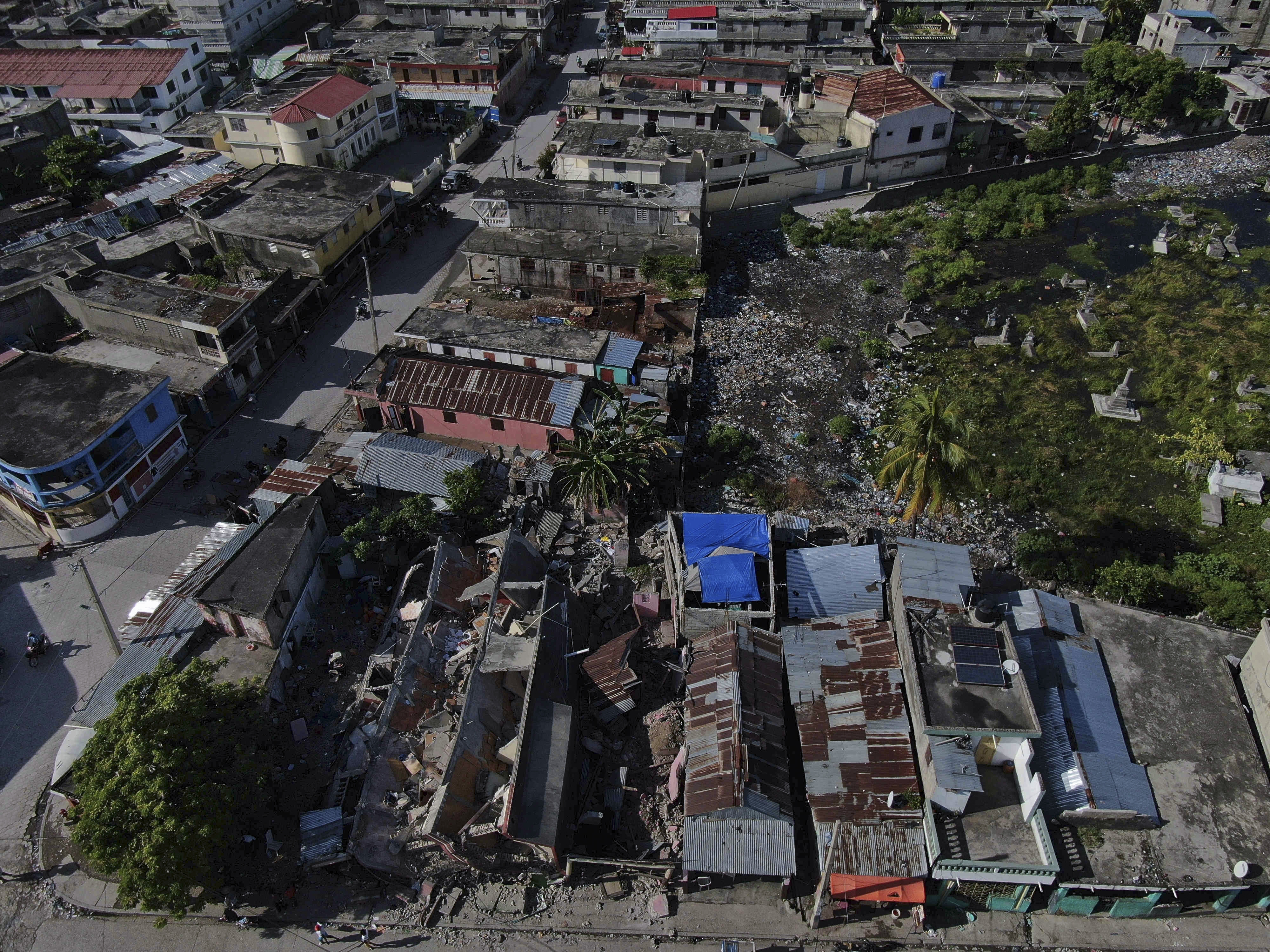 A view of collapsed buildings in Les Cayes