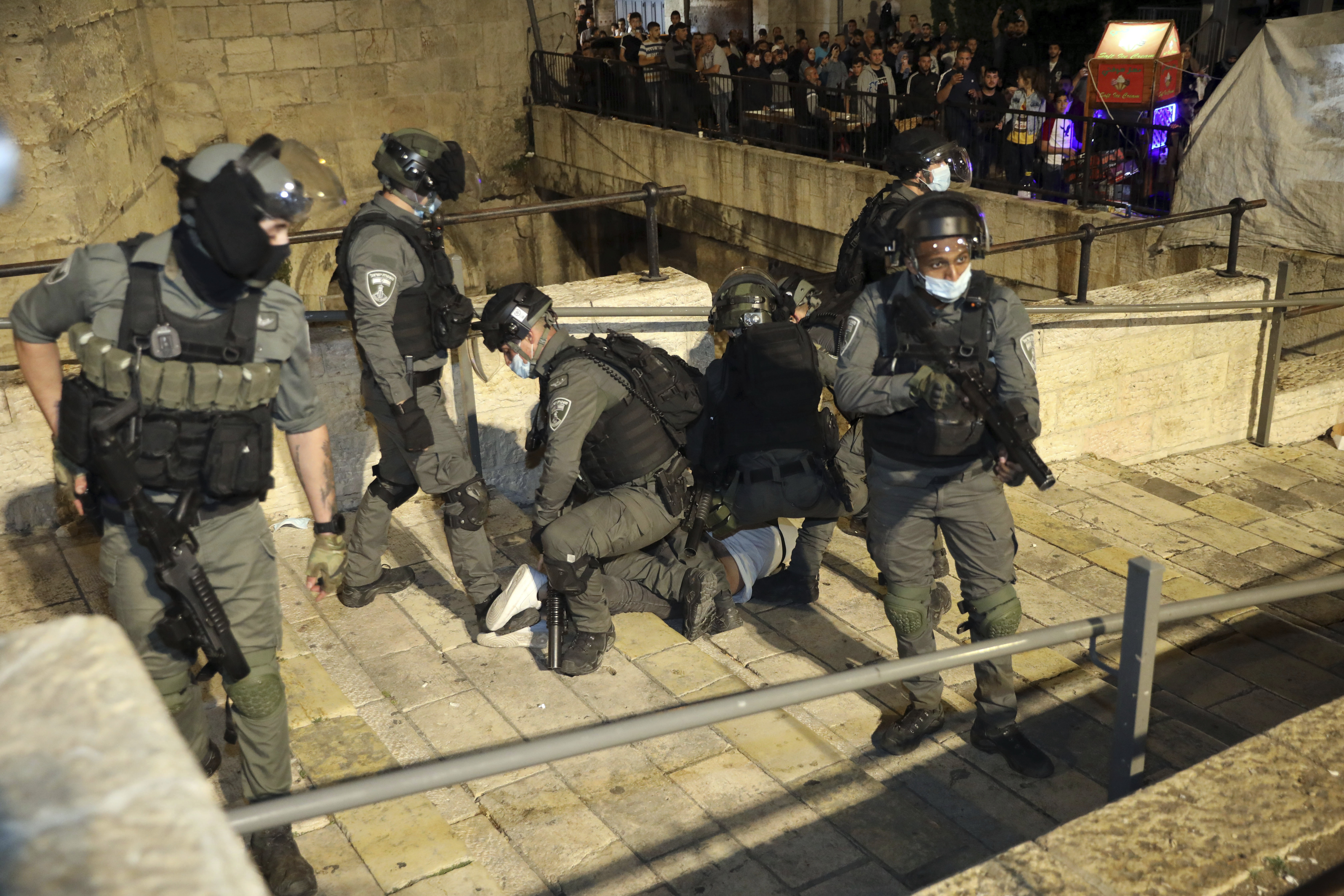 Israeli police forcibly detain a Palestinian outside of the Damascus Gate to the Old City of Jerusalem on Tuesday.