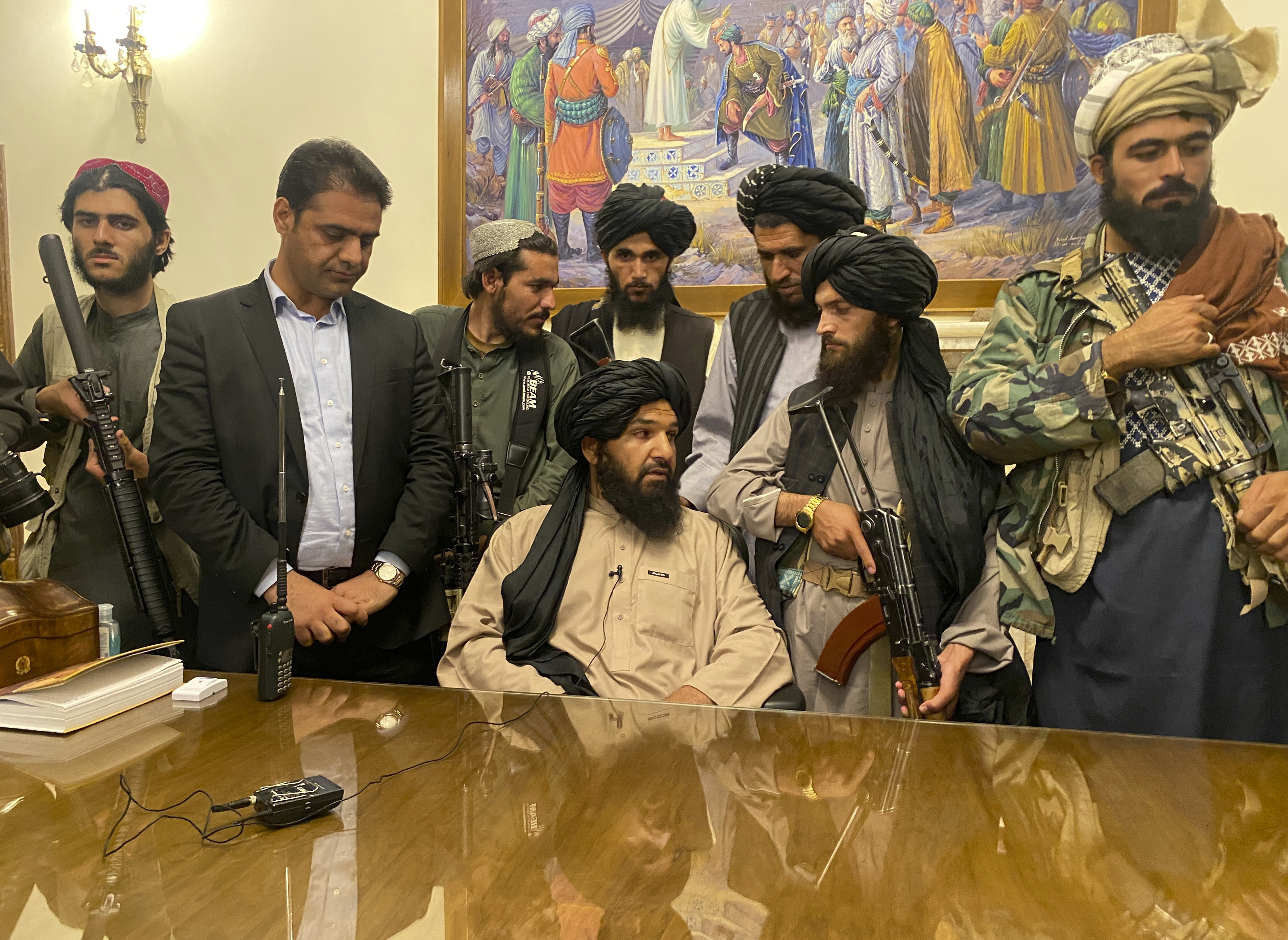 Taliban fighters take control of Afghan presidential palace Sunday.