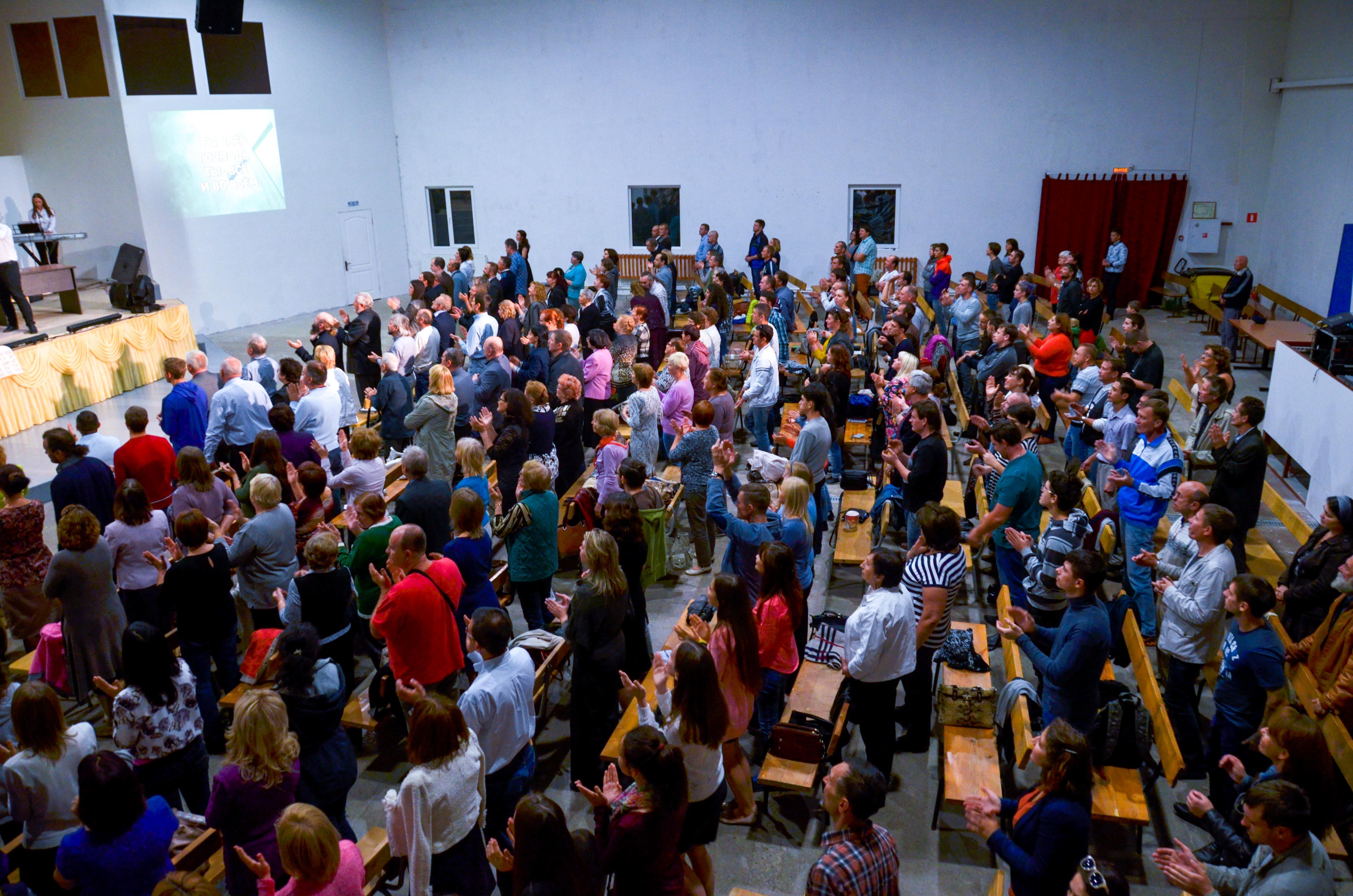 The Word of Life Christians of Evangelical Faith Pentecostal Church congregation meeting before the government closed its building in Kaluga, Russia.
