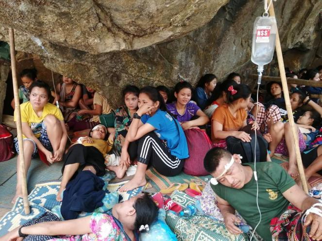 Karen villagers hide in a forest on Sunday following a weekend military airstrike in Papun district of Karen state.