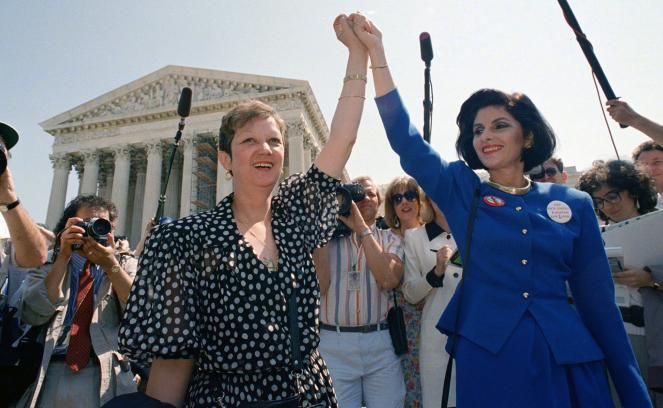McCorvey, left, and her attorney Gloria Allred hold hands as they leave the Supreme Court building in 1989.