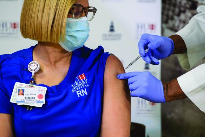 India Medley, chief nursing officer at Howard University Hospital, receives the COVID-19 vaccine on Dec. 15.