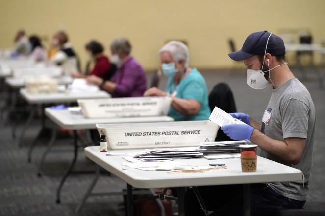 Workers in Pennsylvania prepare main-in ballots for counting.