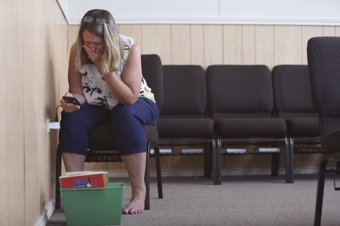 Sherri Pomeroy looks through the  phone belonging to her daughter Annabelle for the first time since the shooting. Law enforcement investigators took the phone from the church for their investigation.