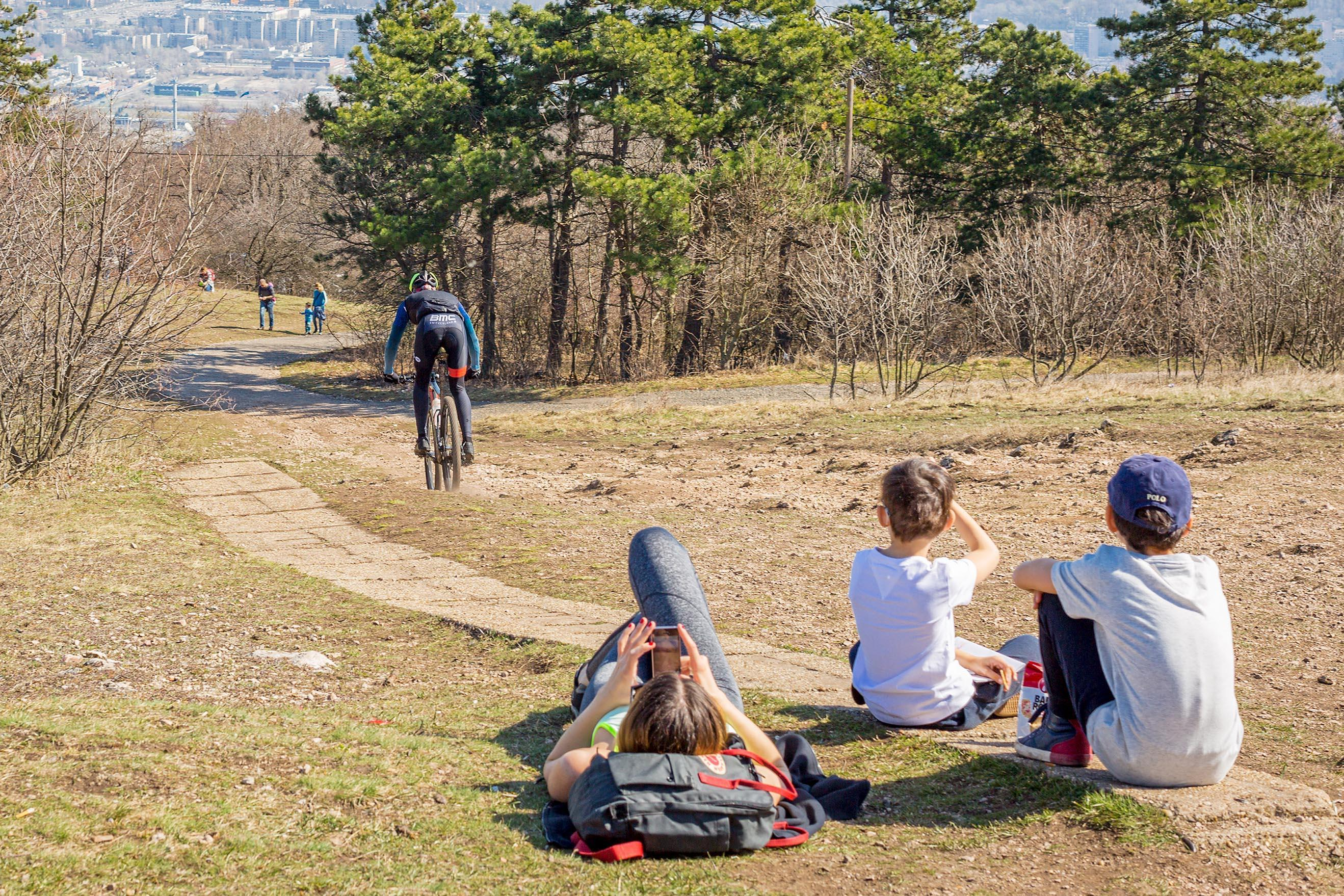 People relax at a park overlooking Budapest, Hungary