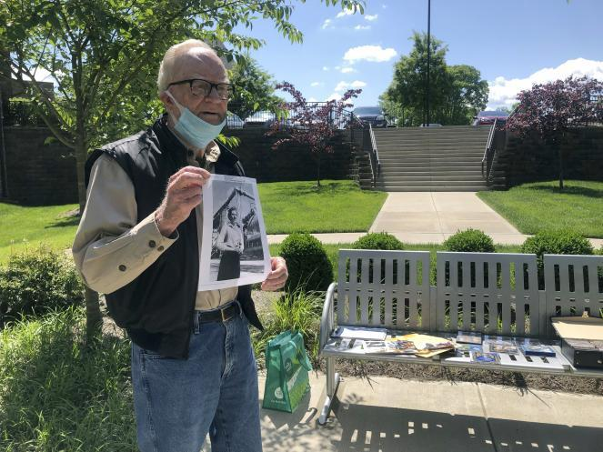 """Retiree Bob Coleman poses with a picture of his late wife, Emily, whom he dedicated a song to on his radio show. Coleman is one of several retirees who have turned into DJs for a new online radio hour known as """"Radio Recliner."""""""