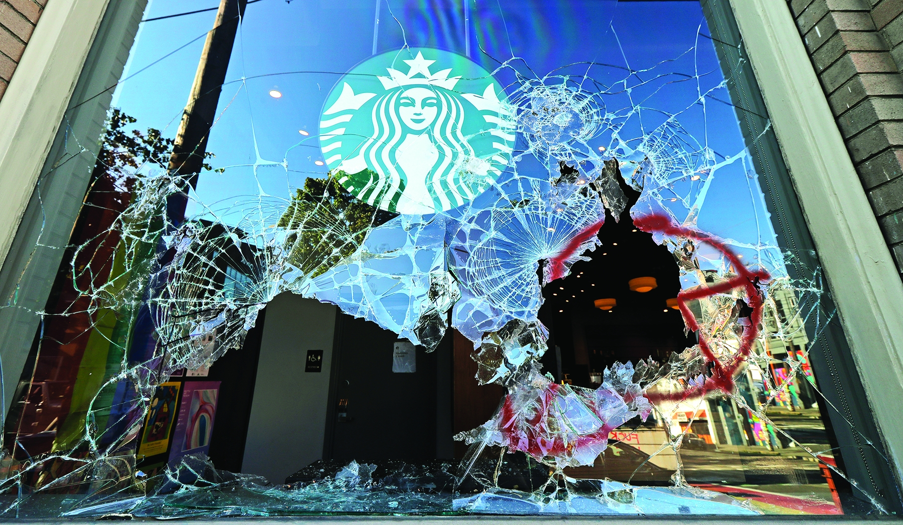 Rioters shattered windows at a Starbucks in Seattle's Capitol Hill neighborhood.