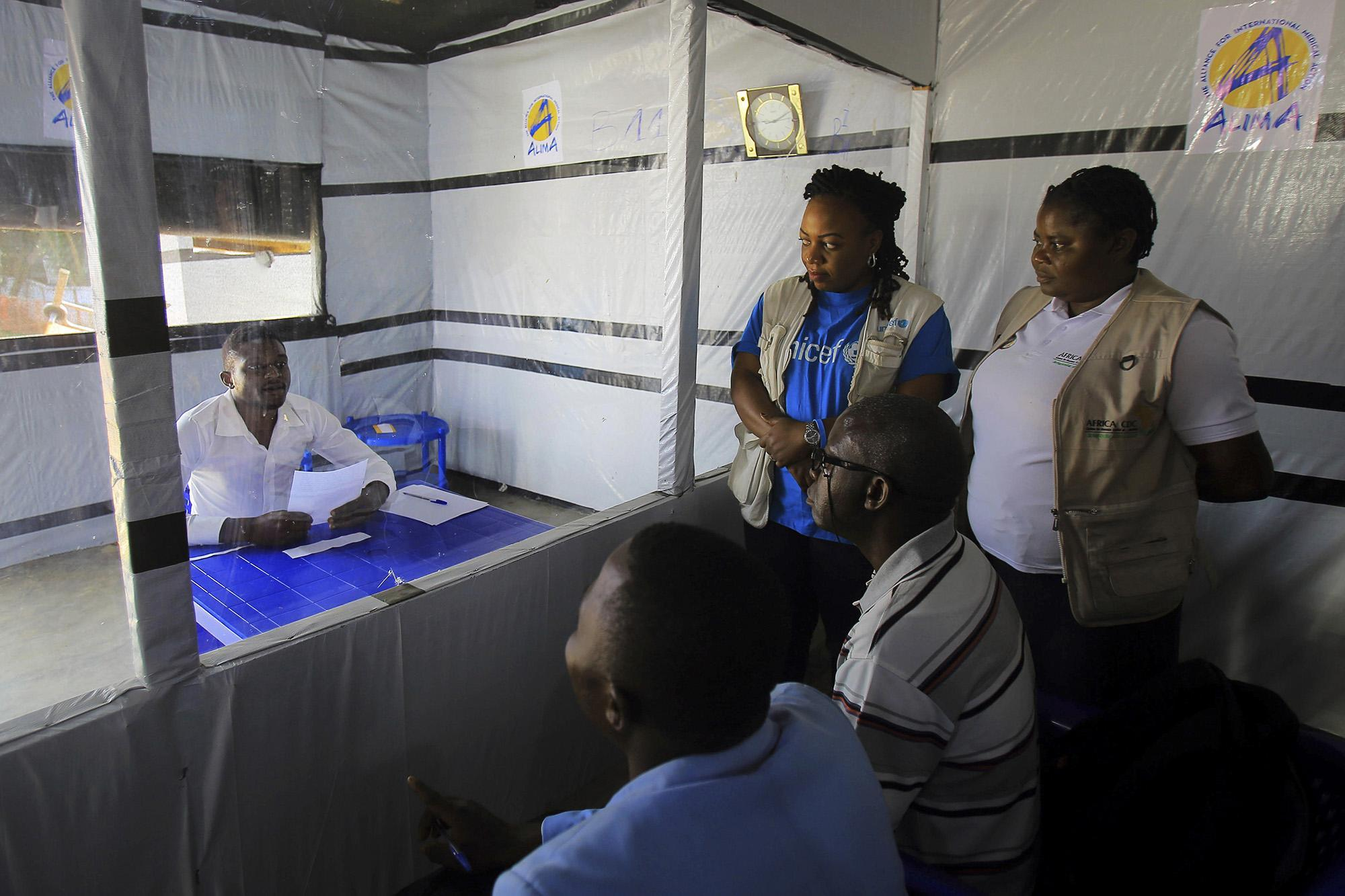 Claude Mabowa Sasi takes his college entrance exam in an isolation unit in Beni, Democratic Republic of Congo.