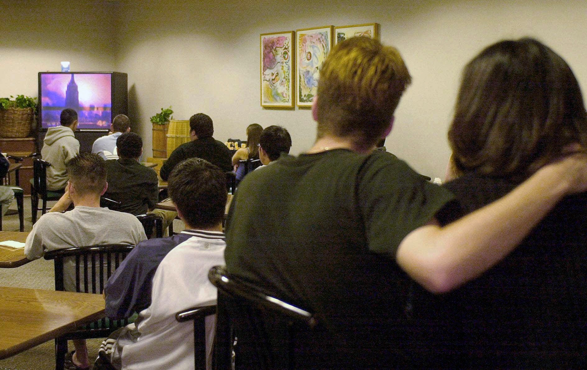 On Sept. 11, 2001, students and others at Ackerman Student Union at UCLA in Los Angeles watch TV coverage of the terror attacks on New York City.