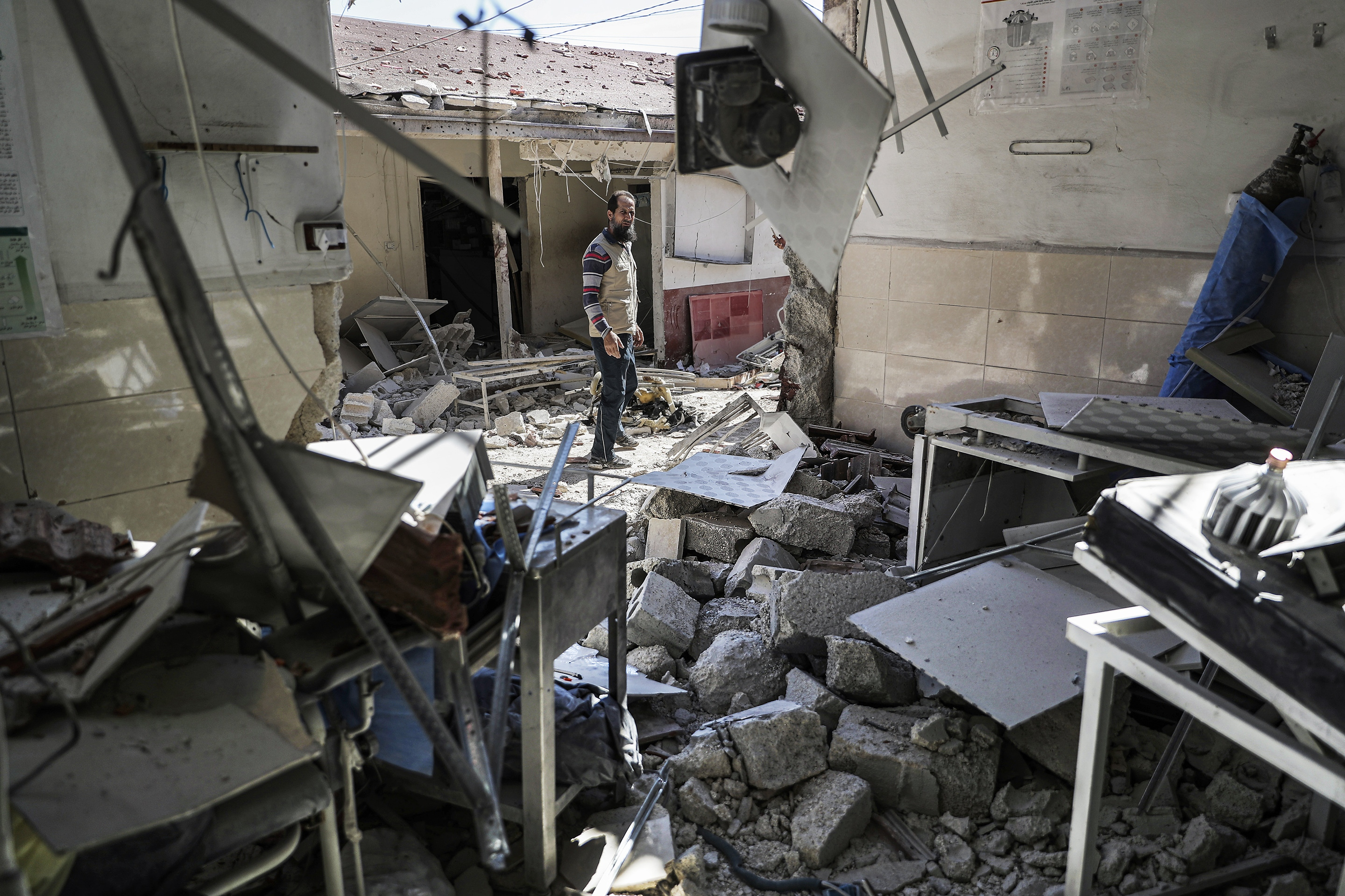 A Syrian man inspects the damage at al-Shifaa Hospital in Syria's northern town of Afrin, which is controlled by Turkish-backed rebels, a day after it was reportedly targeted, along with neighbouring residential areas, by a rocket attack launched by the Syrian government.