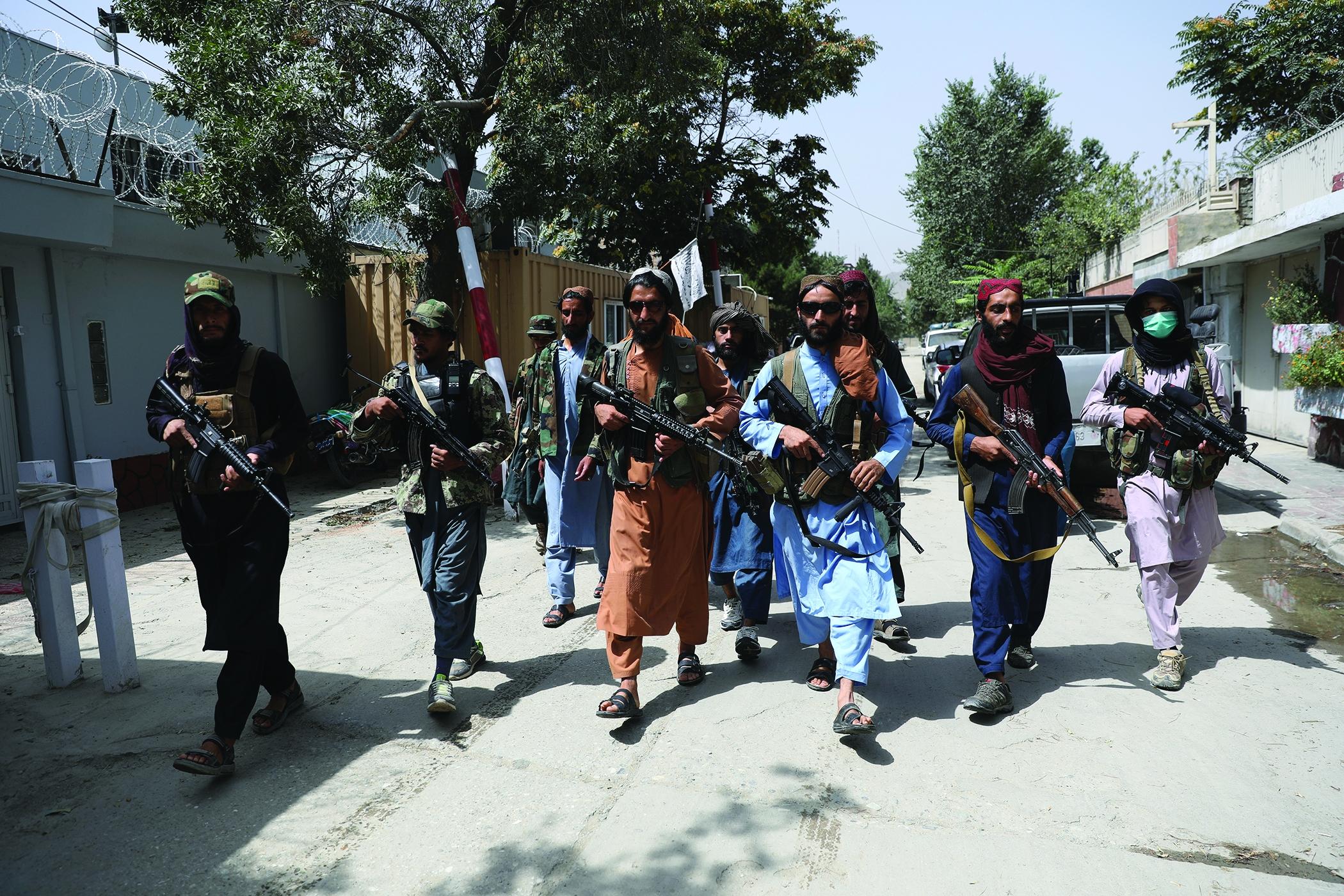 Taliban fighters patrol a Kabul neighborhood.