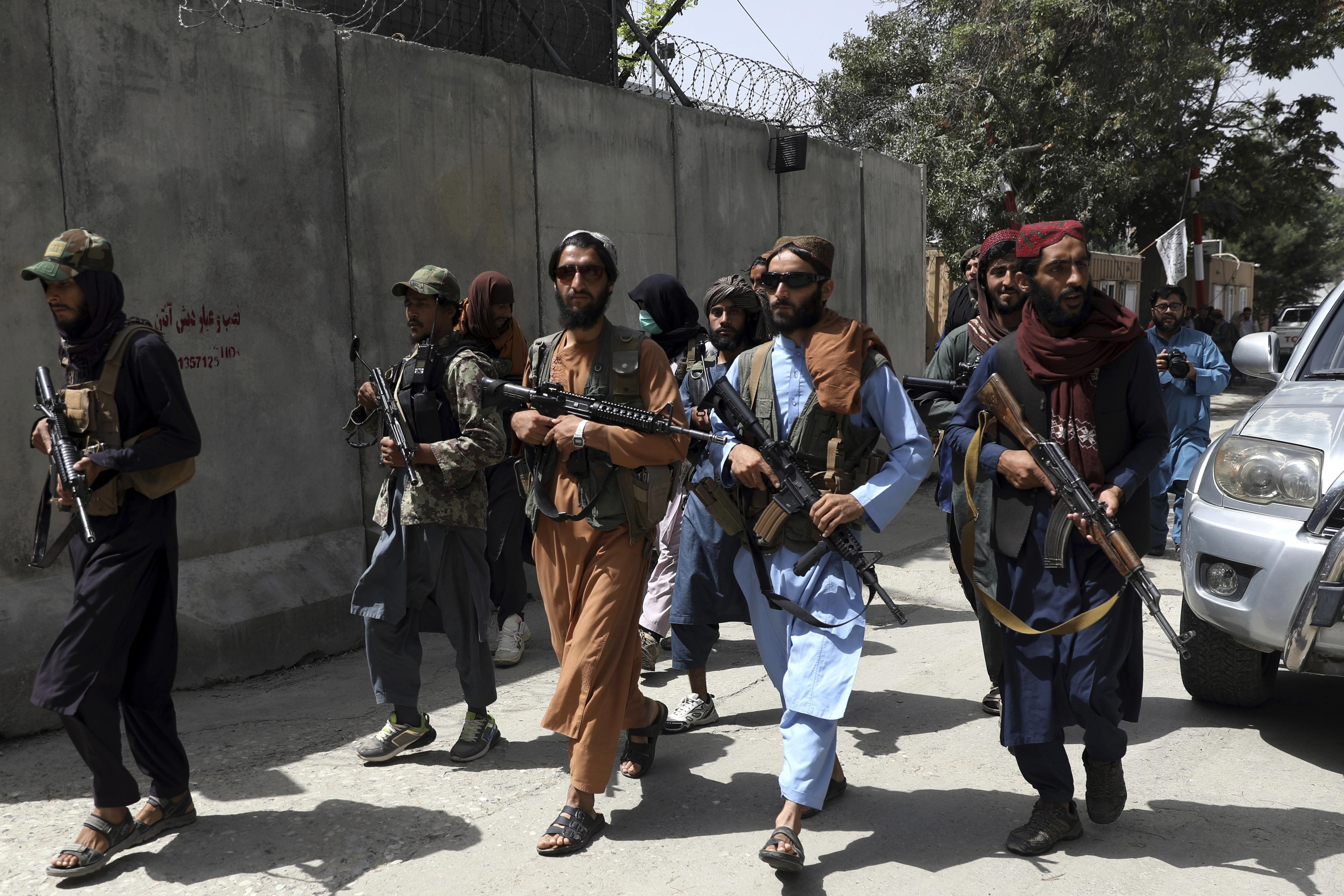 Taliban fighters patrol Wazir Akbar Khan neighborhood in Kabul.
