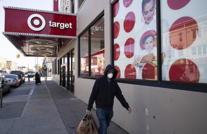 A customer wearing a mask leaves a Target store during the coronavirus pandemic in the Brooklyn borough of New York.
