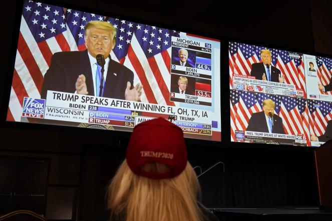 A live broadcast of President Donald Trump speaking from the White House is projected on screens at an election night party in Las Vegas on Tuesday.