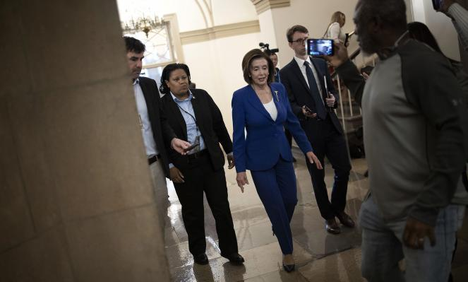 Nancy Pelosi arrives at the U.S. Capitol to vote on the stimulus bill.