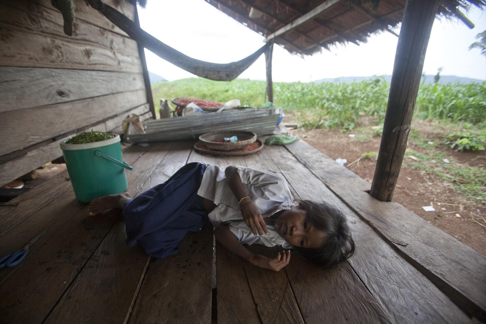 A child afflicted with malaria in a village in Cambodia
