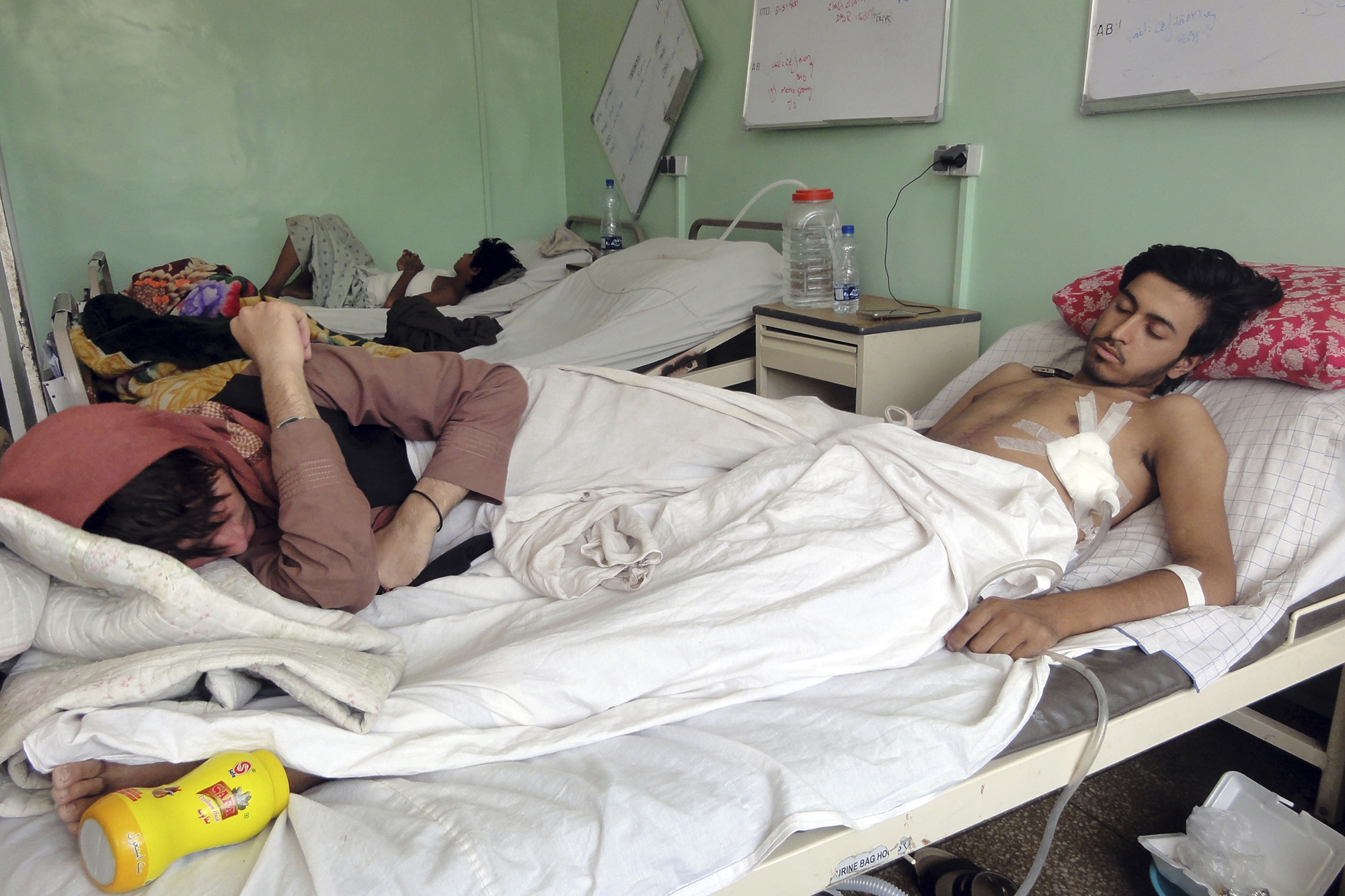 Afghans wounded in fighting between the Taliban and the government in Kandahar province.