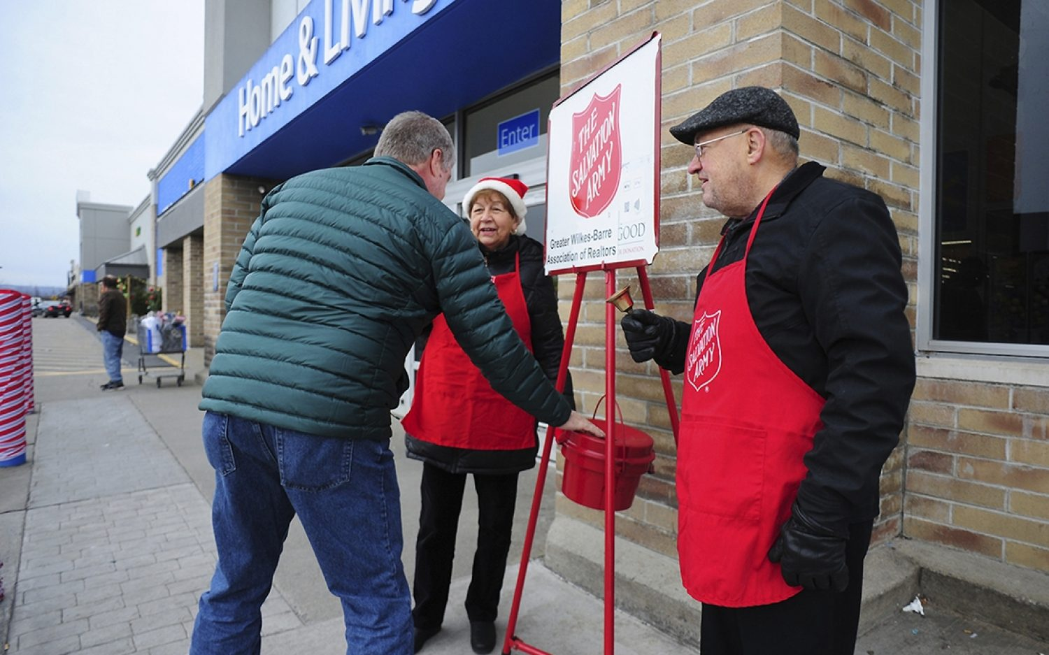 Bell ringers collect gift that glitters
