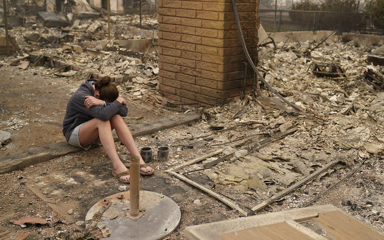 Fires turn deadly in western U.S.