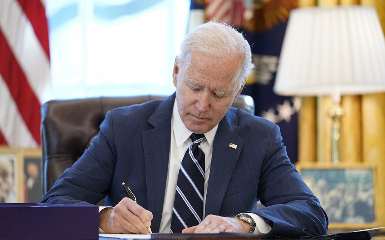 Biden signs economic stimulus bill
