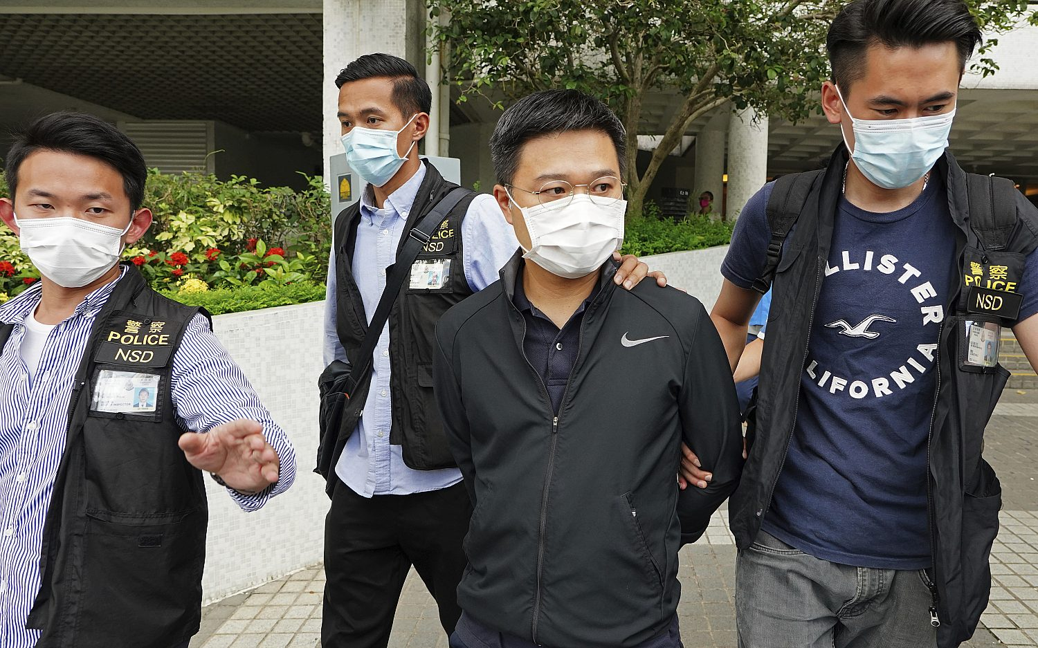 Hong Kong police arrest Apple Daily's editor in chief
