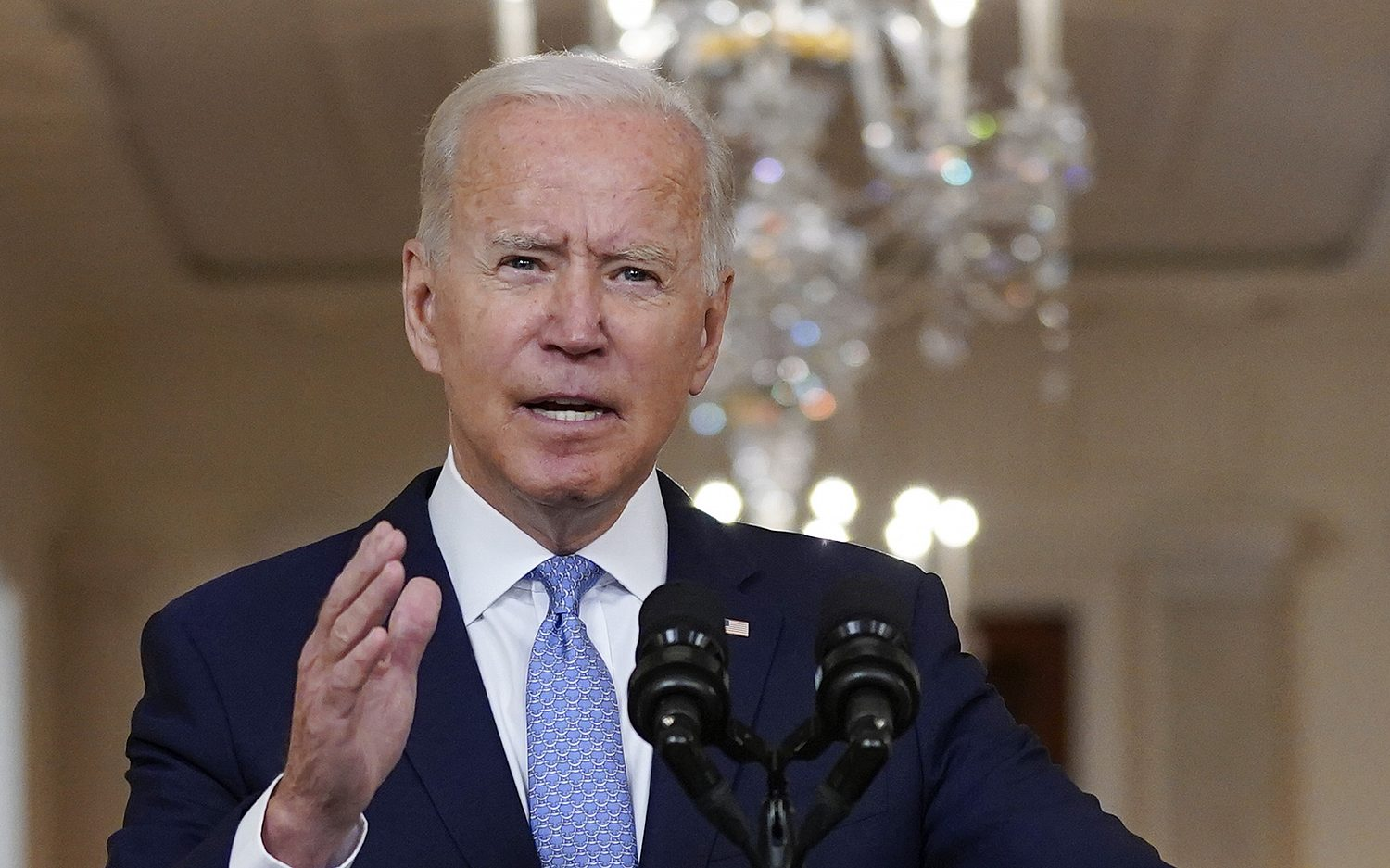 With Americans still in Afghanistan, Biden claims success