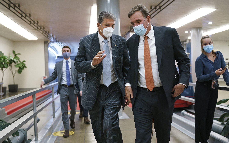 Democrats negotiate cuts to massive spending bill