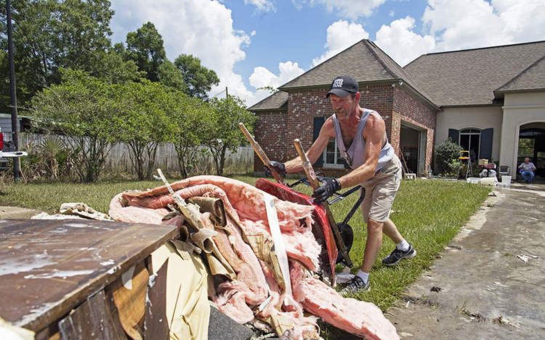 Volunteers begin massive cleanup effort in Louisiana