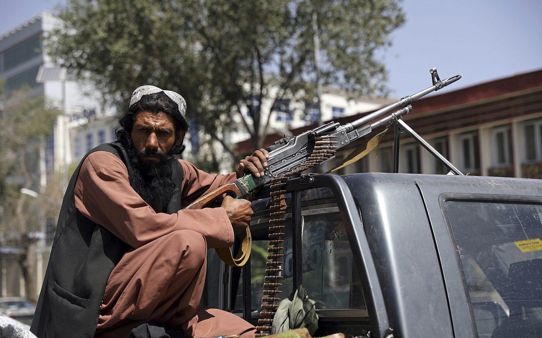 The Taliban seizes power while taking names