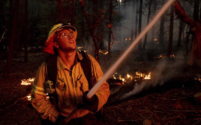 Biden surveys wildfire damage