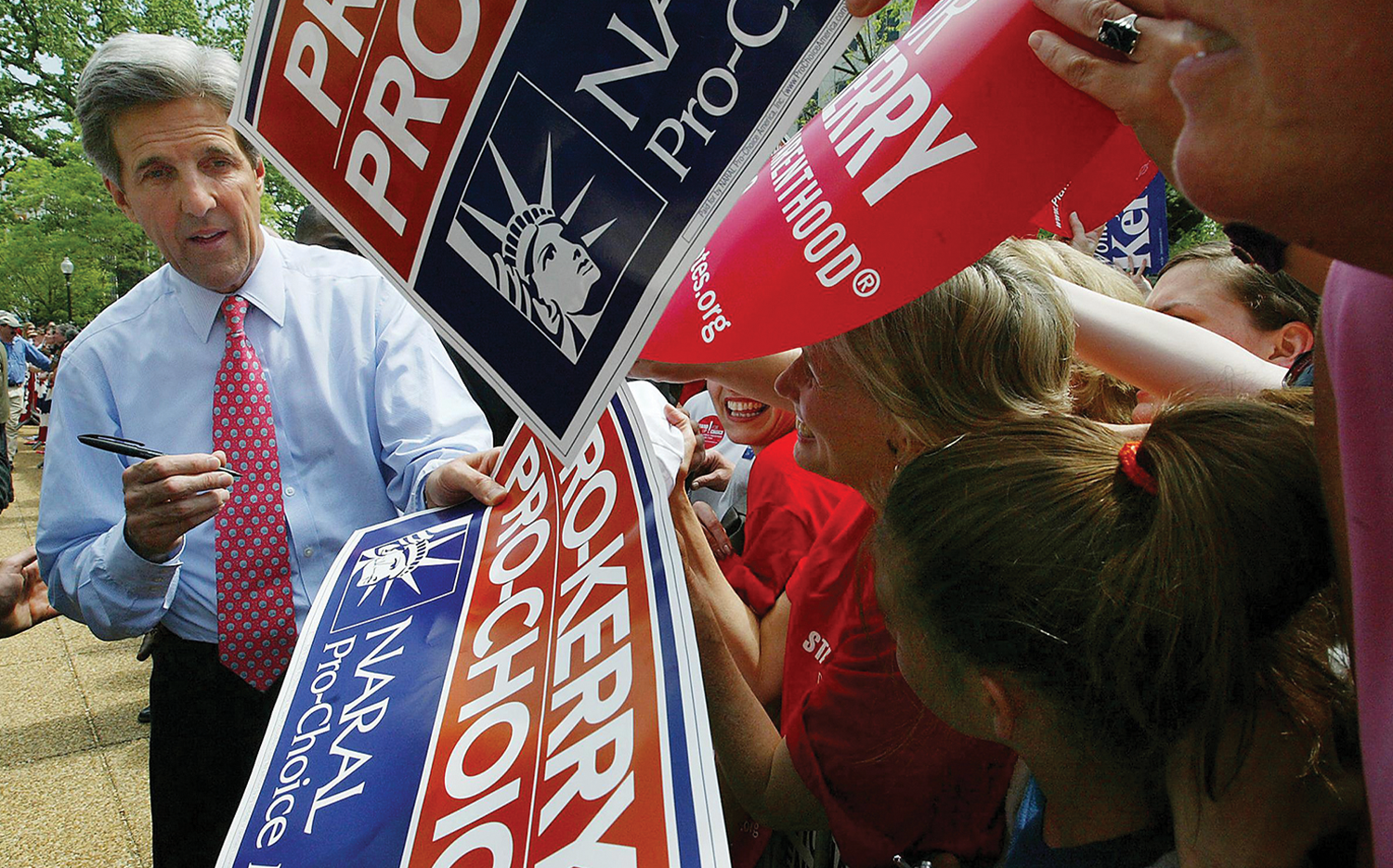 John Kerry signs autographs for pro-abortion supporters during his 2004 campaign.