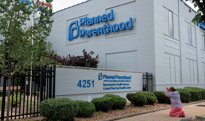 Pro-life activist Kim Chadwell prays in front of thePlanned Parenthood in St. Louis on May 29.