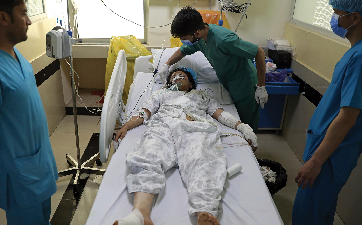 An Afghan student is treated at a hospital after she  was injured by deadly bombings outside a school in Kabul on May 8.