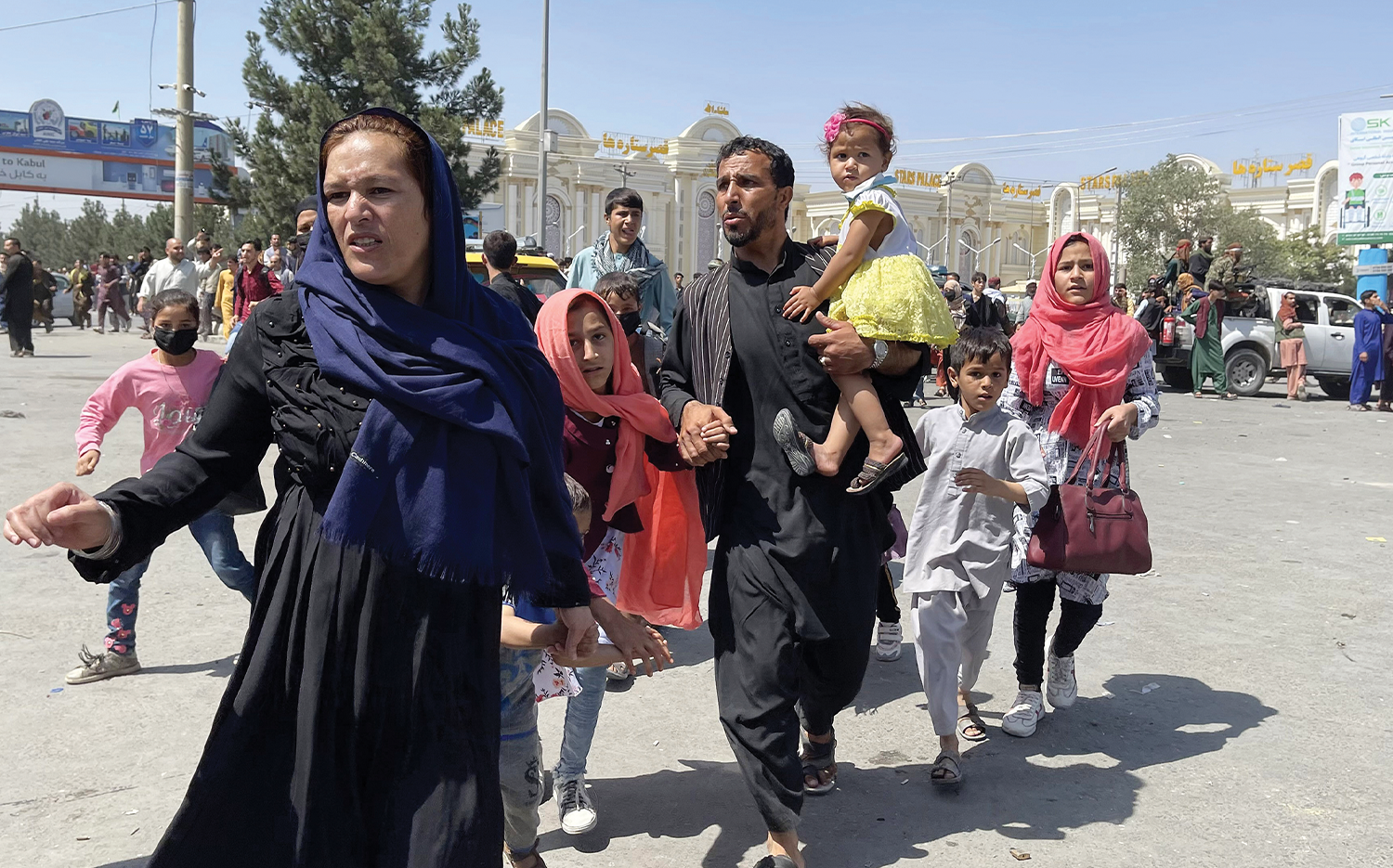 An Afghan family flees to the Kabul airport.