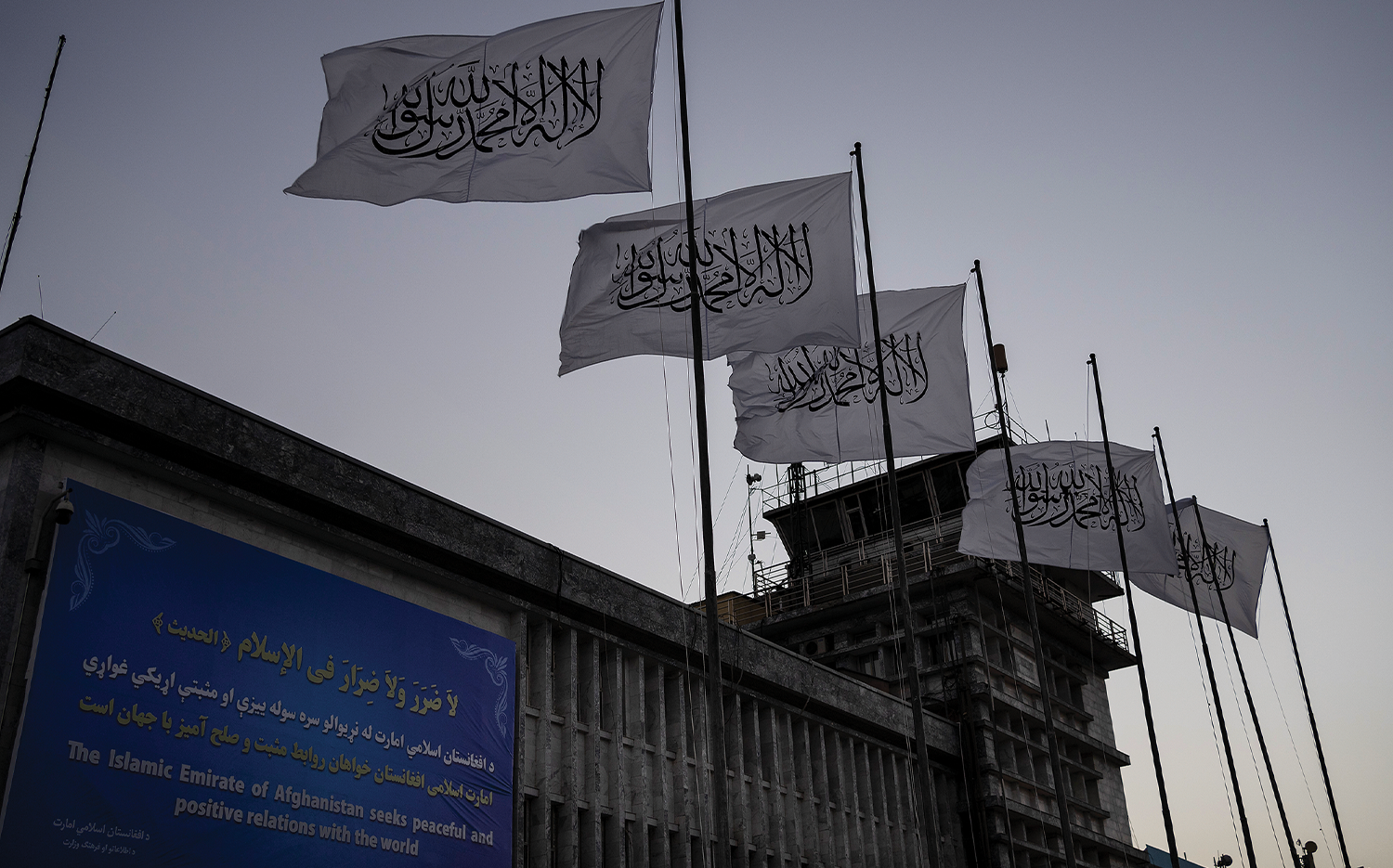 Taliban flags flutter at the airport in Kabul on Sept. 9