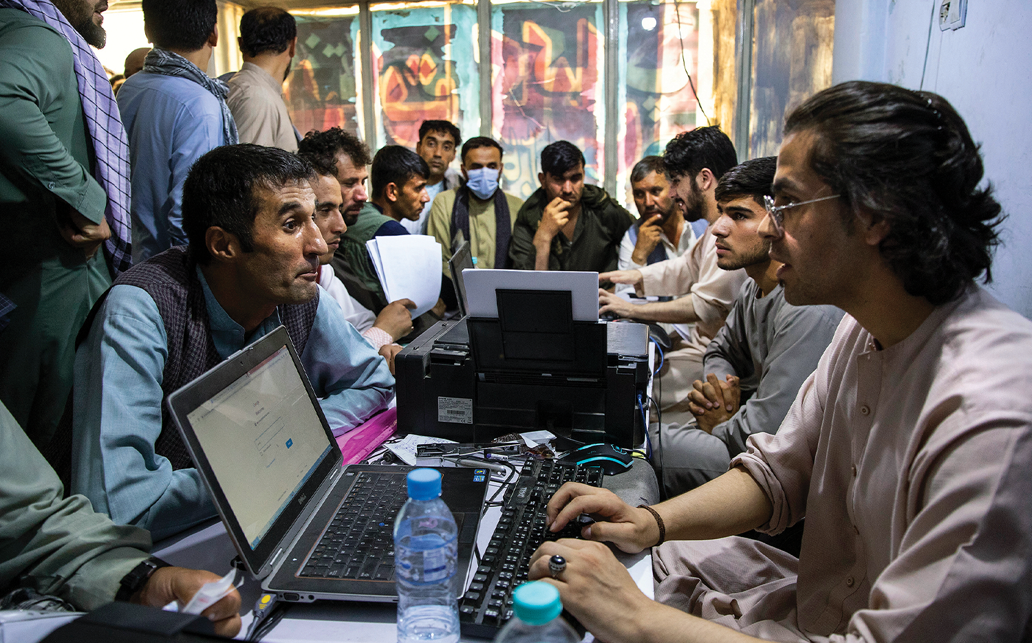 Afghan Special Immigrant Visa (SIV) applicants crowd into an internet café in Kabul on Aug. 8 to apply for the SIV program.